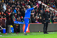 Stoke City Manager Paul Lambert gives orders to his team in the final few minutes as AFC Bournemouth Assistant Manager Jason Tindall left checks his watch during AFC Bournemouth vs Stoke City, Premier League Football at the Vitality Stadium on 3rd February 2018