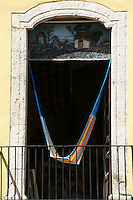 Colourful hammock hanging in the open window of a store in Merida, Yucatan, Mexico...