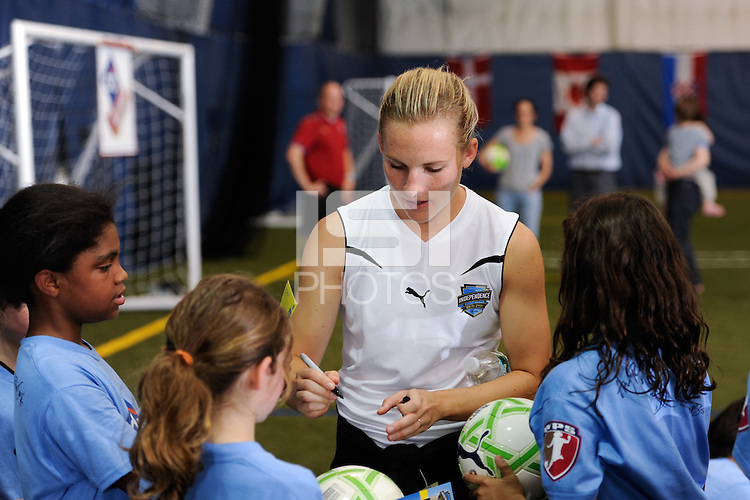 Amy Rodriguez of the Philadelphia Independence signs autographs during a Women's Professional Soccer (WPS) soccer clinic at the Starfinder Foundation Facility in Philadelphia, PA, on May 24, 2011.
