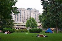 Picnics on grass in Moscow Alexander Garden near the State Duma, Russian Parliament
