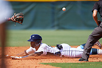 GCL Rays right fielder Diego Infante (17) slides into second base in front of umpire Trevor Matthews during a game against the GCL Twins on August 9, 2018 at Charlotte Sports Park in Port Charlotte, Florida.  GCL Twins defeated GCL Rays 5-2.  (Mike Janes/Four Seam Images)