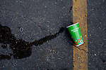 Kendrick Brinson.LUCEO..A spilled cup outside of the Walmart in Williston, North Dakota. Residents complain that prices at their Wal Mart are much higher than elsewhere due to an influx of people moving there and not having a lot of shopping options. Williston is currently experiencing an influx of people relocating there for the town's third oil boom...Model Released: No.Assigning Editor: Michael Wichita.