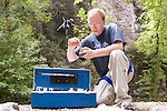 0707-20.College of Biology and Agriculture.Environmental Science Brochure..Keith Merrill collecting specimens and Scott Allen doing chemical analysis. ..July 17, 2007..Photography by Jaren Wilkey..Copyright BYU Photo 2007.All Rights Reserved .photo@byu.edu  (801)422-7322.