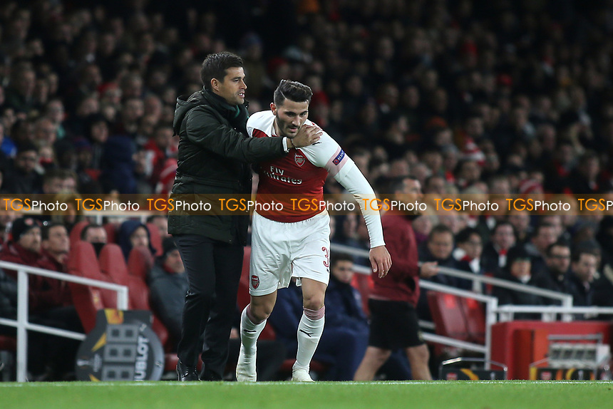 Arsenal's Sead Kolasinac almost collides with Sporting Lisbon Head Coach, Tiago Fernandes during Arsenal vs Sporting Lisbon, UEFA Europa League Football at the Emirates Stadium on 8th November 2018