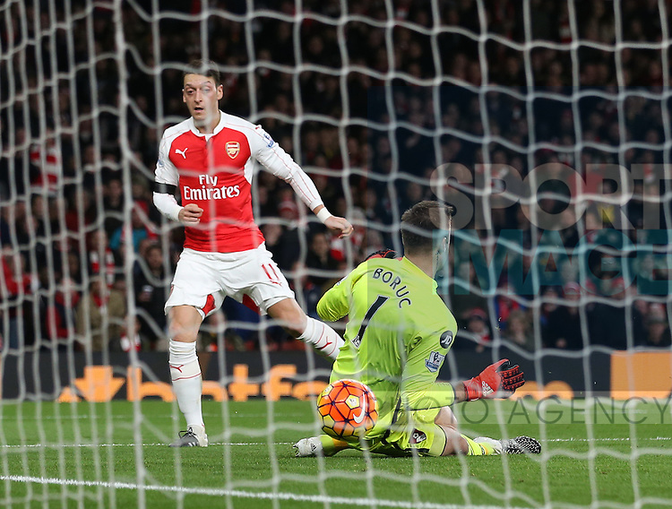 Arsenal's Mesut Ozil scoring his sides second goal<br /> <br /> Barclays Premier League- Arsenal vs AFC Bournemouth - Emirates Stadium - England - 28th December 2015 - Picture - David Klein/Sportimage