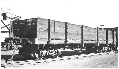 3/4 view of D&amp;RGW high-side gondola #9019 at Alamosa.  Note the &quot;condemned&quot; stencilled above the car number on the side.<br /> D&amp;RGW  Alamosa, CO  Taken by Ward, Bert H. - 7/10/1946