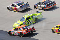 Sept. 21, 2008; Dover, DE, USA; Nascar Sprint Cup Series driver Tony Stewart (20) goes low to avoid a spinning Paul Menard (15) during the Camping World RV 400 at Dover International Speedway. Mandatory Credit: Mark J. Rebilas-