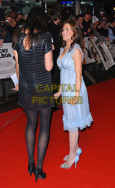 """LISA SNOWDON & MELINDA MESSENGER.Attending the""""Rocky Balboa"""" Uk Premiere,.Vue West End, London, England,.January 16th 2006..full length black sequined striped dress blue grey dress.CAP/CAN.©Can Nguyen/Capital Pictures"""