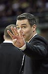Tony Bennett, Washington State Head Coach, lets the officials know how many fouls one of his players has during the Cougars Pac-10 conference showdown with the University of Washington on March 7, 2009, in Seattle, Washington.  Both teams came in to the game on a roll, and in a hard fought battle, the Huskies prevailed 67-60 to wrap up the regular season Pac-10 championship.