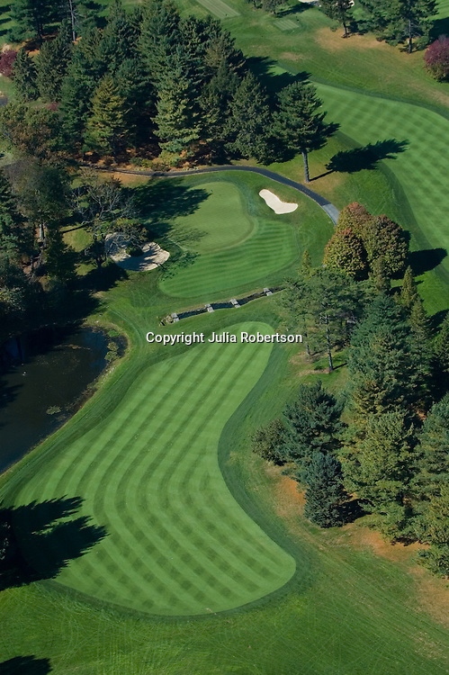 Aerial view of generic golf course fairway, hole, sand trap, greens, bunker