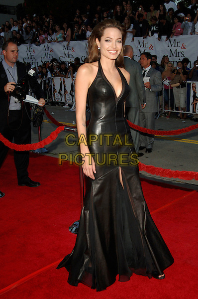 "ANGELINA JOLIE.At the ""Mr. & Mrs. Smith"" World Premiere held at Mann Village Theatre, Hollywood, CA, .USA, 7 June 2005..full length black halterneck dress cleavage low cut .Ref: ADM.www.capitalpictures.com.sales@capitalpictures.com.©Jacqui Wong/AdMedia/Capital Pictures."