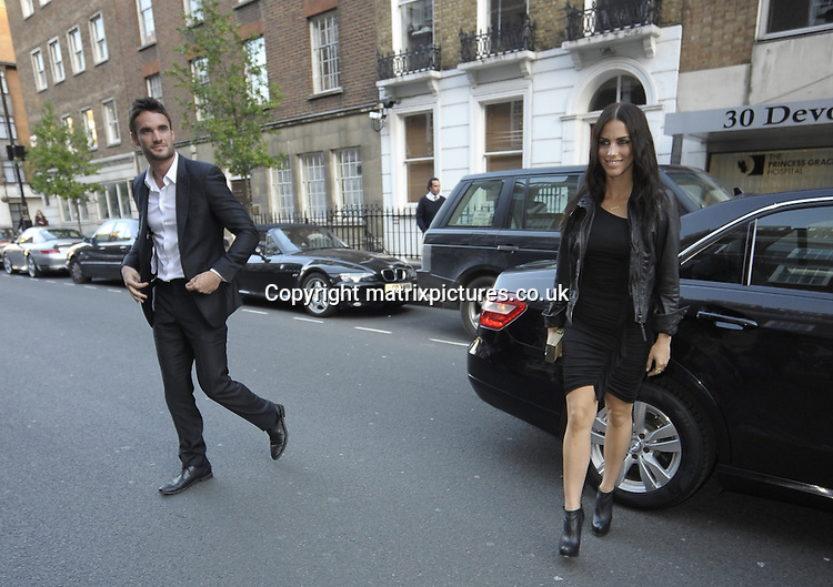 "NON EXCLUSIVE PICTURE: MATRIXPICTURES.CO.UK.PLEASE CREDIT ALL USES..WORLD RIGHTS..Canadian actress Jessica Lowndes is spotted attending Fenton Bailey's ""Human Relations"" photography exhibition in London with her new boyfriend, Scottish former rugby player Thom Evans...Evans used to date English glamour model and TV presenter Kelly Brook, and Lowndes used to date Brook's current beau, Danny Cipriani...MAY 1st 2013..REF: PSE 132923"