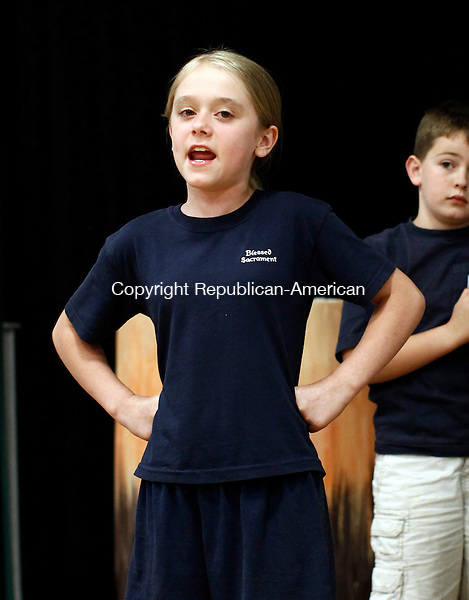 """Waterbury, CT- 02 June 2014-060214CM08- Mia Gagnebin as """"Slightly"""" acts out a scene from Peter Pan, during the Children's Theater at Blessed Sacrament rehearsal in Waterbury on Monday.  Christopher Massa Republican-American"""