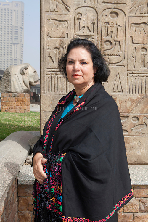 Egypt / Cairo / 27.2.2013 / Wafaa El Saddik poses in front of antiquities in the garden of the Egyptian Museum in Cairo. © Giulia Marchi