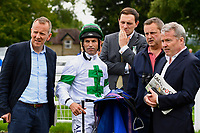 Connections of Archie McKellar with Jockey Pat Dobbs in the parade ring during Afternoon Racing at Salisbury Racecourse on 7th August 2017