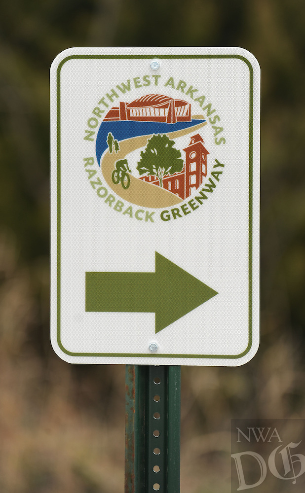 NWA Media/ANDY SHUPE - A sign points the way along a section of the Northwest Arkansas Razorback Greenway, Sunday, Dec. 21, 2014, in Fayetteville. The greenway is a regional trail system that connects Northwest Arkansas.