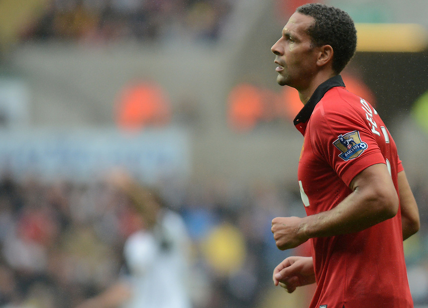 Manchester United's Rio Ferdinand in action during todays match  <br /> <br />  (Photo by Ian Cook/CameraSport) <br /> <br /> Football - Barclays Premiership - Swansea City v Manchester United - Saturday 17th August 2013 - The Liberty Stadium - Swansea<br /> <br /> &copy; CameraSport - 43 Linden Ave. Countesthorpe. Leicester. England. LE8 5PG - Tel: +44 (0) 116 277 4147 - admin@camerasport.com - www.camerasport.com