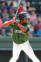 Right fielder Franklin Guzman (10) of the Greenville Drive bats in a game against the Asheville Tourists on Sunday, July 20, 2014, at Fluor Field at the West End in Greenville, South Carolina. Asheville won game one of a doubleheader, 3-1. (Tom Priddy/Four Seam Images)