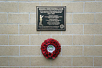 Pictured: A wreath laid under the unveiled plaque Sunday 09 November 2014<br />