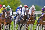 ..Runners and riders in the  Derrinstown Stud apprentice handicap take the turn at Killarney Races on Monday evening, Kings Road (Pink and White) ridden by Ben Curtis won the race, Sun Disc (Green and Black) was second and Solar Sail (Dark Green and red diamonds) was third ....................