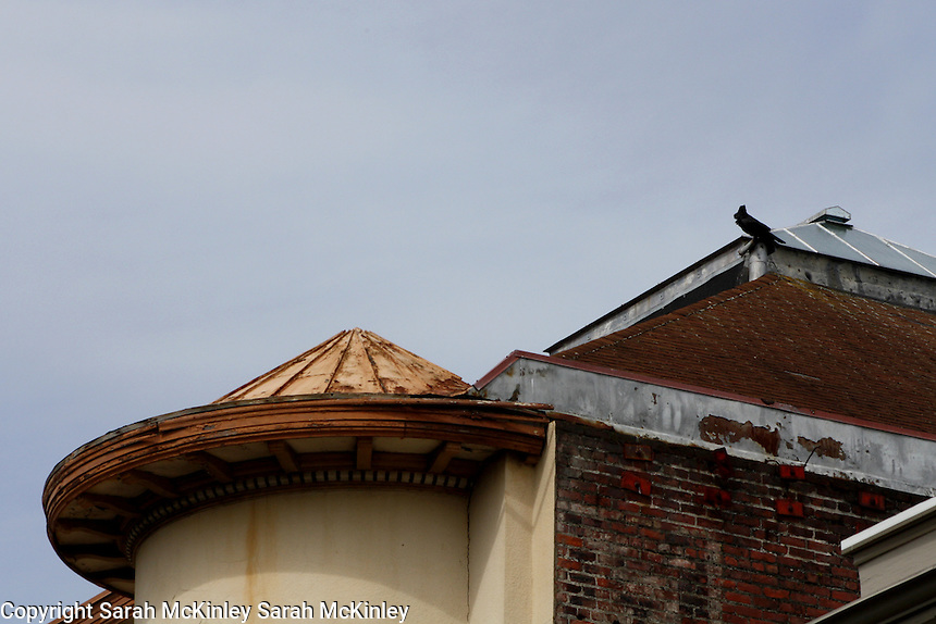 The pointed, rusty, circular roof on a building on 3rd Street in Old Town Eureka in Humboldt County in Northern California.