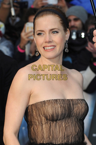 Amy Adams <br /> 'Man Of Steel' UK film premiere, Empire cinema, Leicester Square, London, England.<br /> 12th June 2013<br /> half length headshot portrait beige black strapless pattern alice band dangling earrings brown<br /> CAP/BEL<br /> &copy;Tom Belcher/Capital Pictures