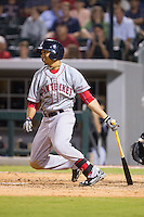 Mookie Betts (12) of the Pawtucket Red Sox follows through on his swing against the Charlotte Knights at BB&T Ballpark on August 9, 2014 in Charlotte, North Carolina.  The Red Sox defeated the Knights  5-2.  (Brian Westerholt/Four Seam Images)