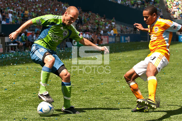 Freddy Ljungberg (l) of the Seattle Sounders dekes Ricardo Clark (r) of the Houston Dynamos in the match at the XBox Pitch at Quest Field on July 11, 2009. The Sounders defeated the Dynamo 2-1.