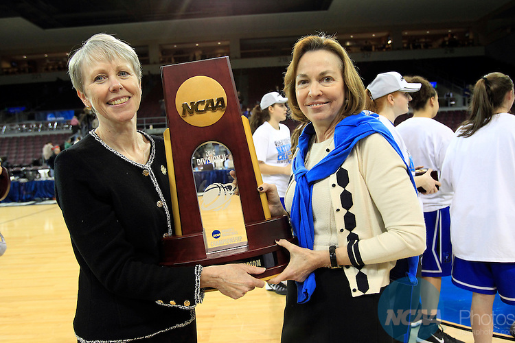 28 MAR 2014: Barbara Stevens,head coach and Gloria Cordes Larso President  of Bentley University pose with the championship trophy after defeating West Texas A&M during the Division II Women's Basketball Championship held at the Erie Insurance Arena in Erie, PA. Bentley defeated West Texas A&M 73-65 for the National title. Harry Scull Jr./NCAA Photos