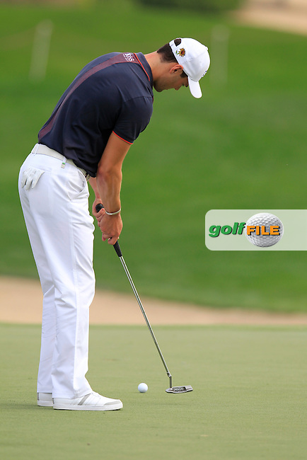 Martin Kaymer (GER) putts on the 8th green during Sunday's Final Round of the Abu Dhabi HSBC Golf Championship 2015 held at the Abu Dhabi Golf Course, United Arab Emirates. 18th January 2015.<br /> Picture: Eoin Clarke www.golffile.ie