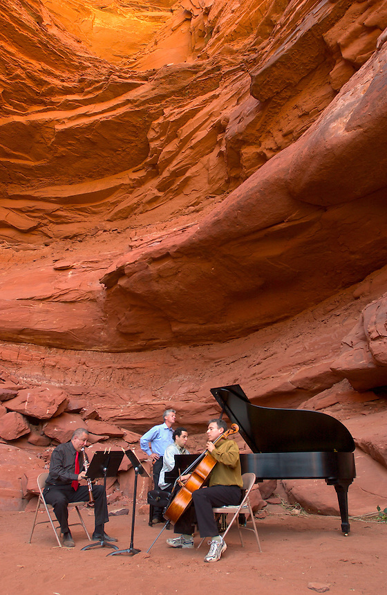 Clarinetist Paquito D'Rivera, left, music director Michael Barrett, pianist Alon Yavnai and cellist Mark Summer warmup with Brahms' Trio in A Minor, Op. 114 before a concert at a natural red rock grotto in a Colorado River canyon wall, for the Moab Music Festival in Moab, Utah, Thursday, Sept. 16, 2004. (Kevin Moloney for the New York Times)