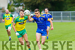 Daniel O'Shea Ballymac gets to the ball ahead of Conor Herlihy Gneeveguilla during their Junior Championship quarter final in Castleisland on Saturday
