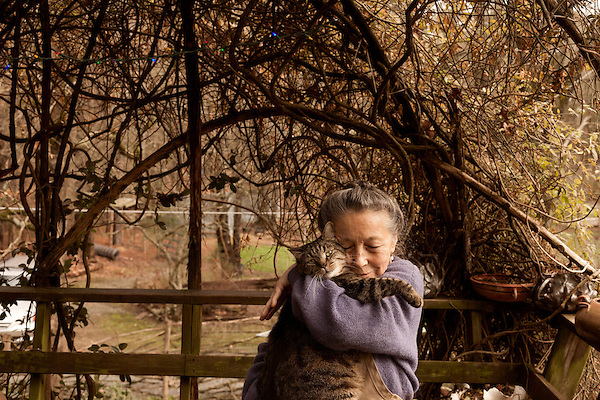 January 2, 2013. Pittsboro, North Carolina.. Ms. Scarpa hugs one of the 40 or so cats that live in her private home.. Siglinda Scarpa, originally from northern Italy, runs the Goathouse Refuge, a no kill shelter for cats. Scarpa, who is also a ceramic artist, runs the shelter with 5 full time employees and currently has over 260 cats in the refuge..