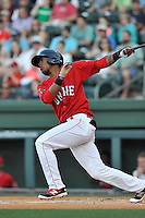 Right fielder Joseph Monge (15) of the Greenville Drive bats in a game against the Columbia Fireflies on Saturday, April 23, 2016, at Fluor Field at the West End in Greenville, South Carolina. Columbia won, 7-3. (Tom Priddy/Four Seam Images)