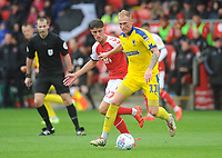 AFC Wimbledon's Mitch Pinnock under pressure from Fleetwood Town's Harrison Biggins<br /> <br /> Photographer Kevin Barnes/CameraSport<br /> <br /> The EFL Sky Bet Championship - Fleetwood Town v AFC Wimbledon - Saturday 10th August 2019 - Highbury Stadium - Fleetwood<br /> <br /> World Copyright © 2019 CameraSport. All rights reserved. 43 Linden Ave. Countesthorpe. Leicester. England. LE8 5PG - Tel: +44 (0) 116 277 4147 - admin@camerasport.com - www.camerasport.com