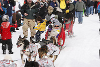Saturday March 6 , 2010  Lance Mackey gives a ride to a youngster along the trail during the ceremonial start of the 2010 Iditarod in Anchorage , Alaska