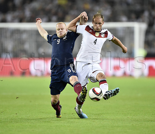 07.09.2014. Dortmund, Germany.   international match Germany Scotland  in Signal Iduna Park in Dortmund. Benedikt Howedes (GER) challenged by Steven Naismith (SCO)