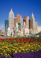 overview of entire grounds of New York New York casino with brightly colored flowers in foreground. Las Vegas Nevada USA.