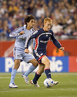 New England Revolution midfielder Jeff Larentowicz (13) advances the ball as Colorado Rapids midfielder Mehdi Ballouchy (8) defends. The New England Revolution defeated the Colorado Rapids, 1-0, at Gillette Stadium in Foxboro, MA on September 29, 2007.