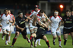 Ulster flanker Iain Henderson crashes through the Dragons defence brushing aside Jonathan Evans..Celtic League.Newport Gwent Dragons v Ulster.Rodney Parade.26.10.12.©Steve Pope