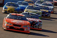Nov 13, 2005; Phoenix, Ariz, USA;  Nascar Nextel Cup driver Tony Stewart , driver of the #20 Home Depot Chevy leads Carl Edwards during the Checker Auto Parts 500 at Phoenix International Raceway. Mandatory Credit: Photo By Mark J. Rebilas