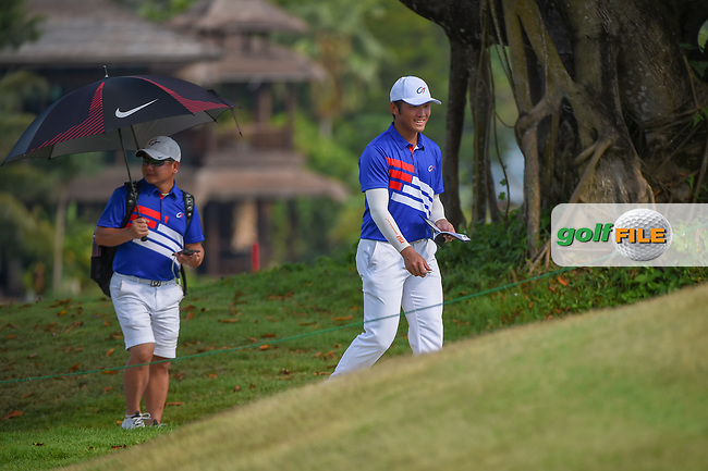 Yung-Hua LIU (TPE) smiles as he makes his way to the tee on 18 during Rd 1 of the Asia-Pacific Amateur Championship, Sentosa Golf Club, Singapore. 10/4/2018.<br /> Picture: Golffile | Ken Murray<br /> <br /> <br /> All photo usage must carry mandatory copyright credit (© Golffile | Ken Murray)