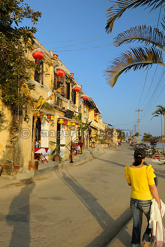 Asia, Vietnam, Hoi An. Hoi An old quarter. Overlooking the attractive Bach Dang river promenade. The historic buildings, attractive tube houses, and decorated community halls have 1999 earned Hoi An's old quarter the status of a UNESCO World Heritage Site. To protect the old quarter's character stringent conversation laws prohibit alterations to buildings, as well as the presence of cars on the roads.