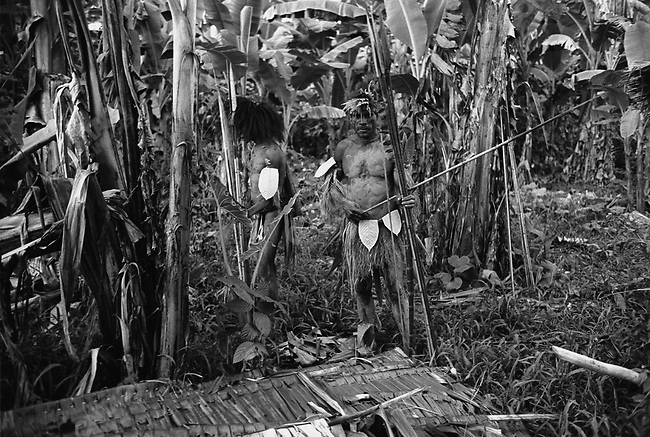 """A group of native tribesmen enter the """"First Contact"""" group's base camp, West Papua, Indonesia, September 2004."""