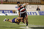 Lelia Masaga tries to break out of the tackle of Warren Smith during the Air NZ Cup rugby game between Bay of Plenty & Counties Manukau played at Blue Chip Stadium, Mt Maunganui on 16th of September, 2006. Bay of Plenty won 38 - 11.