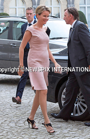 KING PHILIPPE AND QUEEN MATHILDE<br /> attend a Symphony Orchestra in honour of both King Albert II of Belgium and King Baudouin, at the Notre-Dame de la Cambre church in Brussels, Belgium_September 25, 2013.<br /> Mandatory Credit Photos:&copy;NEWSPIX INTERNATIONAL<br /> <br /> **ALL FEES PAYABLE TO: &quot;NEWSPIX INTERNATIONAL&quot;**<br /> <br /> PHOTO CREDIT MANDATORY!!: NEWSPIX INTERNATIONAL(Failure to credit will incur a surcharge of 100% of reproduction fees)<br /> <br /> IMMEDIATE CONFIRMATION OF USAGE REQUIRED:<br /> Newspix International, 31 Chinnery Hill, Bishop's Stortford, ENGLAND CM23 3PS<br /> Tel:+441279 324672  ; Fax: +441279656877<br /> Mobile:  0777568 1153<br /> e-mail: info@newspixinternational.co.uk