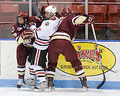 Edwin Shea (BC - 8), Alex Tuckerman (NU - 27), Tommy Cross (BC - 4) - The Northeastern University Huskies defeated the Boston College Eagles 3-2 on Friday, February 19, 2010, at Matthews Arena in Boston, Massachusetts.