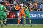 14 September 2013: Carolina's Enzo Martinez (URU) (left) and Tampa Bay's Jay Needham (right) challenge for a header. The Carolina RailHawks played the Tampa Bay Rowdies at WakeMed Stadium in Cary, North Carolina in a North American Soccer League Fall 2013 Season regular season game. The game ended in a 2-2 tie.