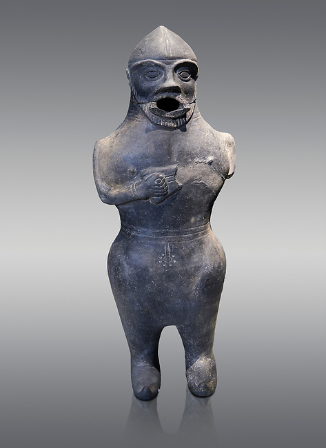 Anthropomorphic Hittite jug in terra cotta from the Hittite Period. Adana Archaeology Museum, Turkey. Against a grey background