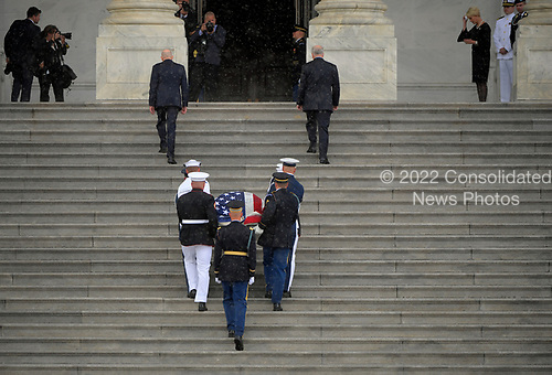 WASHINGTON, DC - AUGUST 31: The casket of Sen. John McCain, R-Ariz., is carried up the steps of the U.S. Capitol in Washington D.C. on Friday, Aug. 31, 2018, in Washington, D.C. (Photo by John McDonnell/The Washington Post, Pool)